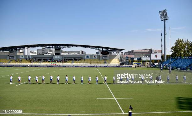 Italy team players sing the national anthem ahead of the during the Scotland v Italy Rugby World Cup 2021 Europe Qualifying match at Stadio Sergio...