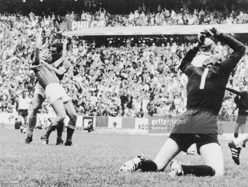 German goalie (Seppmaier (right) pounds the ground with his fists in wrath over Italy's winning goal just scored by Gianni Rivera (L, front) being embraced from behind by teammate Luigi Riva in extra time in their World Soccer Cup match here. Italy won, 4-3.