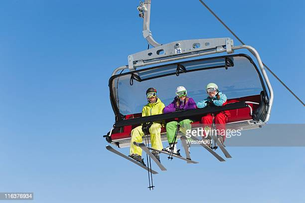 Italy, Trentino-Alto Adige, Alto Adige, Bolzano, Seiser Alm, Group of skiers using ski lift