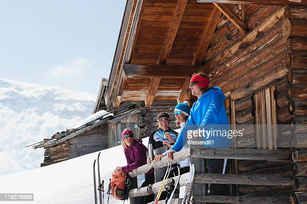 italy, trentino-alto adige, alto adige, bolzano, seiser alm, people standing outside ski resort near railings - alto adige italy stock pictures, royalty-free photos & images