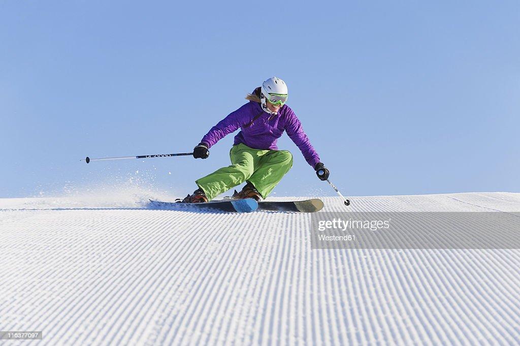 Italy, Trentino-Alto Adige, Alto Adige, Bolzano, Seiser Alm, Young woman skiing : Stock Photo