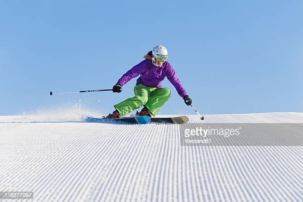 Italy, Trentino-Alto Adige, Alto Adige, Bolzano, Seiser Alm, Young woman skiing