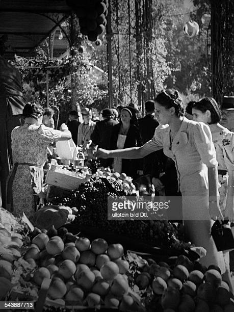 Italy TrentinoAlto Adige Merano People at the fruit market in Meran Photographer Max Ehlert Published by 'Die Dame' 19/1938Vintage property of...