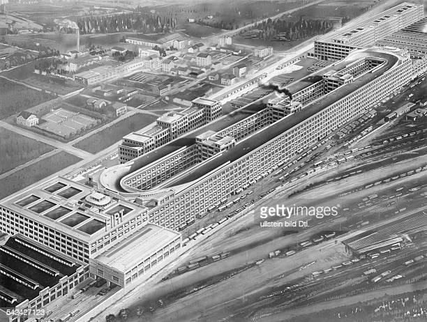 Italy Turin Fiatfactory building with cars crossing the test track on the roof aerial view