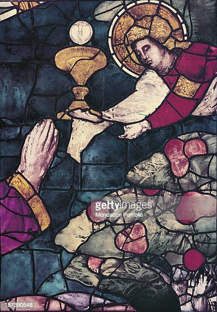 Italy, Tuscany, Florence, Cattedrale di Santa Maria del Fiore, Detail, Joined hands of a prayerful man on knees, An angel with a halo around his head...