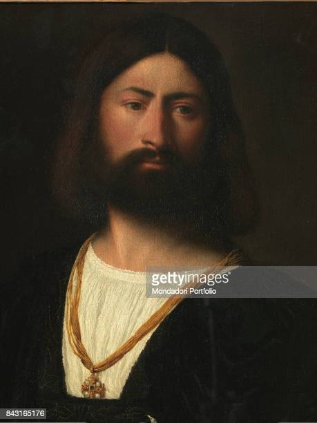 Italy Tuscany Florence Galleria degli Uffizi Detail Man with thick hair and beard in the style of the time wearing a necklace with the Maltese cross...