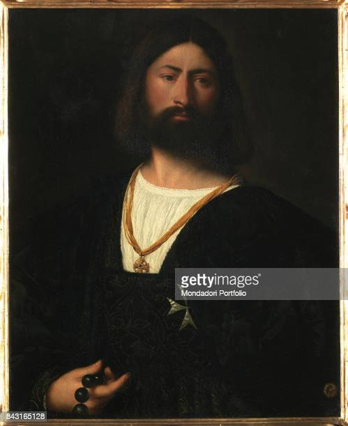 Italy Tuscany Florence Galleria degli Uffizi Whole artwork view Man with thick hair and beard in the style of the time holding a rosary We can argue...