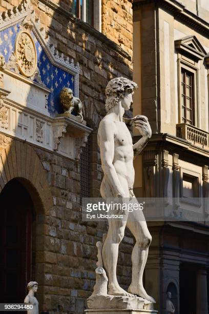 Italy, Tuscany, Florence, Piazza della Signoria, Replica of the famous David statue by Michelangelo with the Palazzo Vecchio as background.