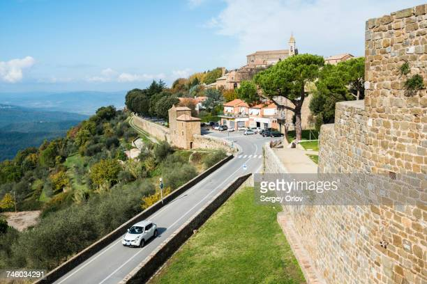 Italy, Tuscany, Montalcino, View of ancient Montalcino city and fortress walls on hill