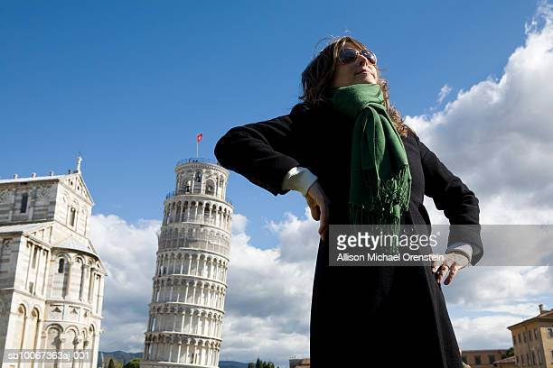 Italy, Tuscany, Pisa, woman and Tower of Pisa
