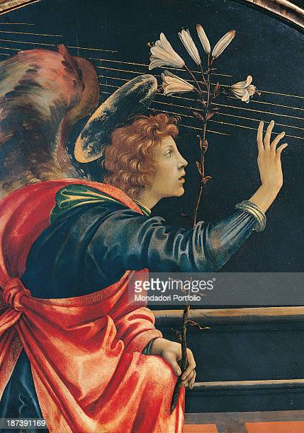 Italy Tuscany San Gimignano Pinacoteca Civica Detail The announcing angel Archangel Gabriel is kneeled down with aureola a blue tunic red cloak and...
