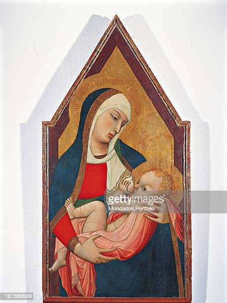 Italy Tuscany Siena Palazzo Arcivescovile All Mary with a halo a red dress and a blue and white veil is breastfeeding the child Jesus in rose arms...