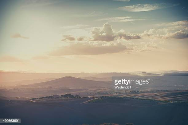 Italy, Tuscany, Val d'Orcia, Rolling landscape in twilight