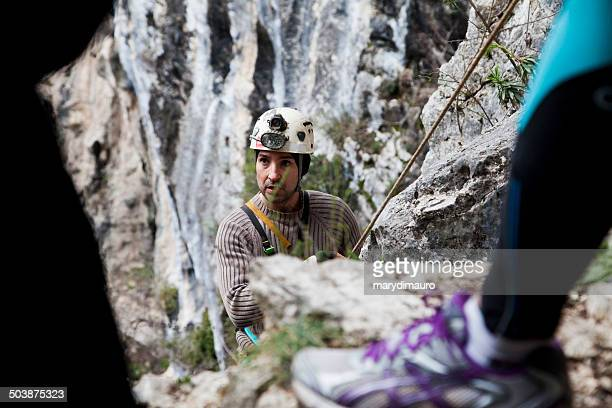 italy, two men climbing - speleology stock pictures, royalty-free photos & images