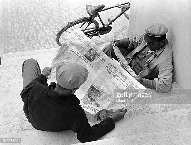 Italy two men reading the newspaper early 1950's