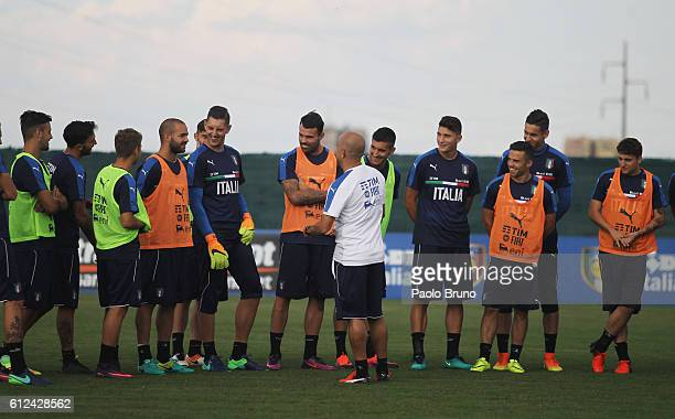 Italy U21 head coach Luigi Di Biagio speaks with his players during the Italy U21 training session on October 4 2016 in Rome Italy