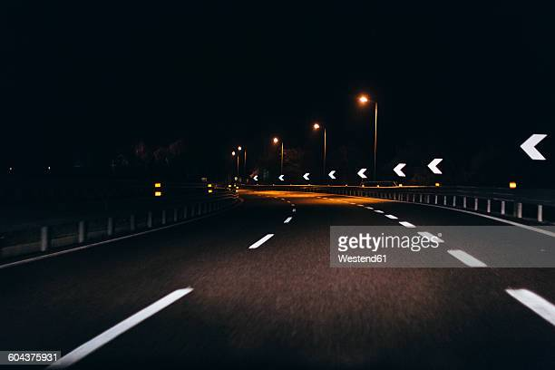 Italy, Udine, driving at night along the highway