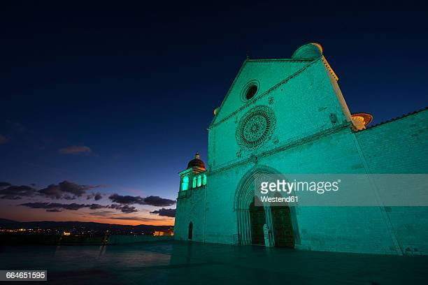 italy, umbria, assisi, basilica of saint francis of assisi in the evening - st. francis of assisi stock photos and pictures