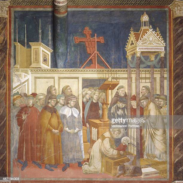 Italy Umbria Assisi Papal Basilica of San Francesco Upper Church Whole artwork view St Francis leaning over the manger takes in his arms the infant...