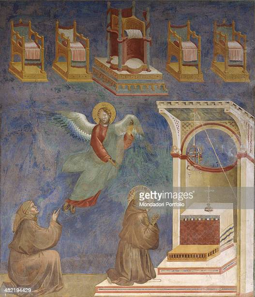 Italy Umbria Assisi Papal Basilica of San Francesco Upper Church Detail Saint Francis knelt in prayer in front of an altar Beside him a second friar...