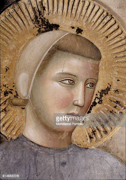 Italy Umbria Assisi Upper Church of the Basilica of StFrancis in Assisi Detail The face of San Francis surrounded by an halo