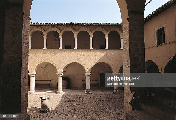 Italy, Umbria, Ferentillo, Abbazia di San Pietro in Valle, All, The inner cloister of the abbey on the countryside, with a two order of round arcaded...