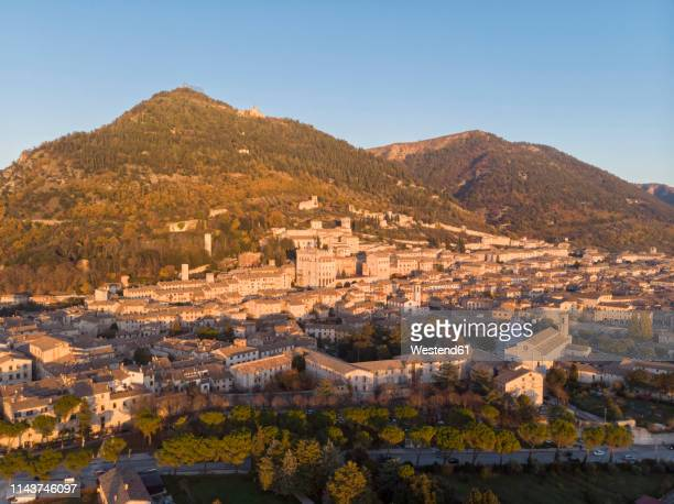 italy, umbria, gubbio, the town and the roman theater at sunset - gubbio stock pictures, royalty-free photos & images