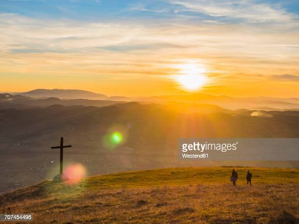 italy, umbria, gubbio, two boys hiking at sunset - gubbio stock pictures, royalty-free photos & images
