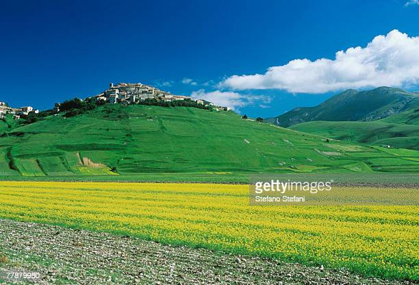 italy, umbria, monti sibillini national park, castle on hill, spring - umbria stock pictures, royalty-free photos & images