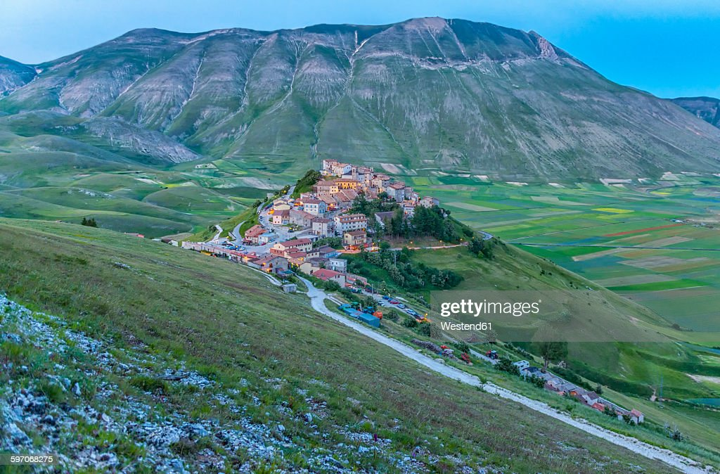 Italy, Umbria, Monti SIbillini National Park, the small town of Castelluccio di Norcia and the Vettore mountain at sunset : Stock Photo