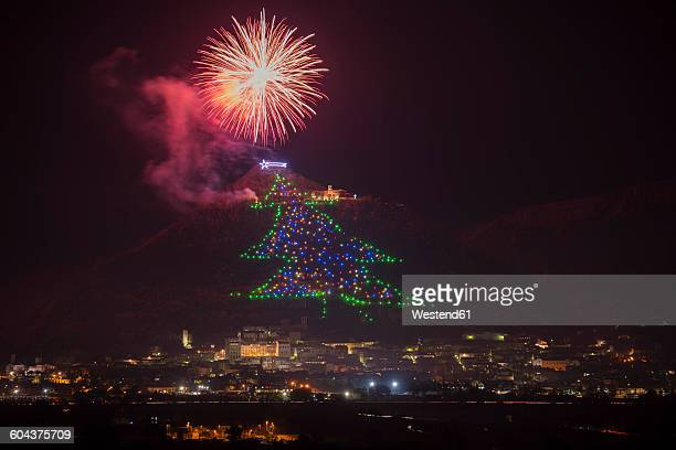 italy, umbria, province of perugia, gubbio, christmas tree on mount ingino, fireworks - gubbio stock pictures, royalty-free photos & images