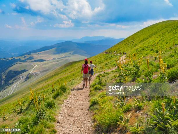italy, umbria, sibillini mountains, two children hiking mount vettore - umbria stock pictures, royalty-free photos & images