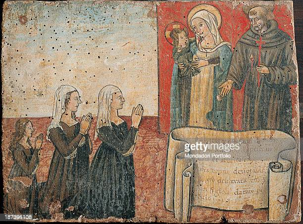 Italy Umbria Trevi Pinacoteca Civica All Three women kneeled down with their heads veiled thank Holy Mary with Christ child and Saint Joseph who...