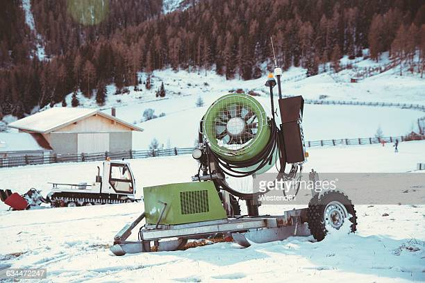 Italy, Val Venosta, Slingia, snow cannon in winter landscape