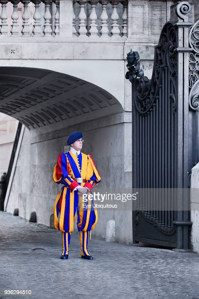Italy, Vatican City, St Peters Square with Swiss Guard on duty.