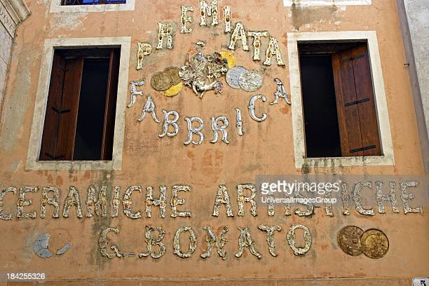 Italy Veneto Bassano del Grappa hill town in the foothills of the Dolomites a exterior display of an old lamp shop