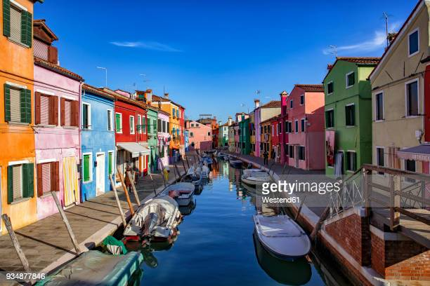 Italy, Veneto, Burano, canal with boats and colourful houses