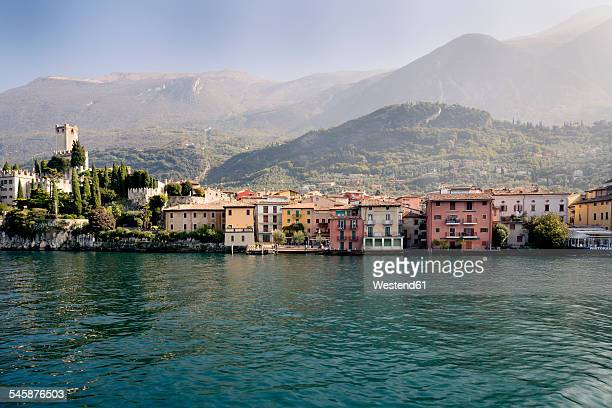 italy, veneto, malcesine, view of the city with castello scaligero - veneto stock pictures, royalty-free photos & images