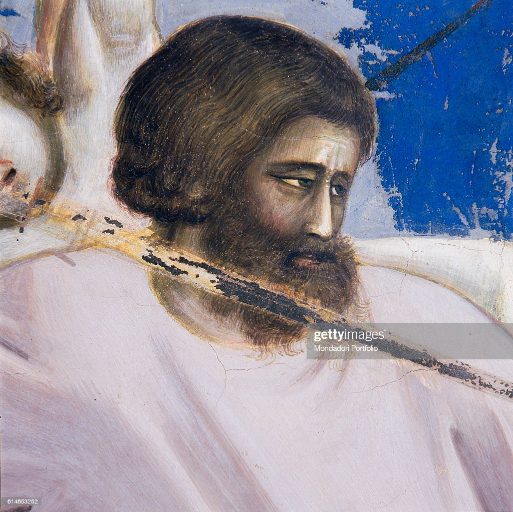 Italy, Veneto, Padua, Scrovegni Chapel.Executioner aiming at his next victim with his sword. Behind his shoulder, the scream of a child.