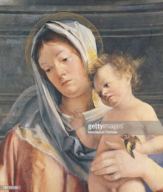 Italy Veneto Quinto di Treviso Chiesa di Santa Cristina al Tiverone Close up of the Virgin Mary with pink dress blue mantle veil halo with the Infant...