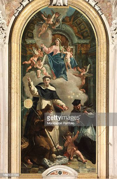 Italy Veneto Rovigo Gavello parish church Whole artwork view The representation consists of many figures set in a false apse decorated with gold...