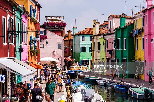 Italy, Veneto, Venice, Burano, Colourful houses and tourists by the canal