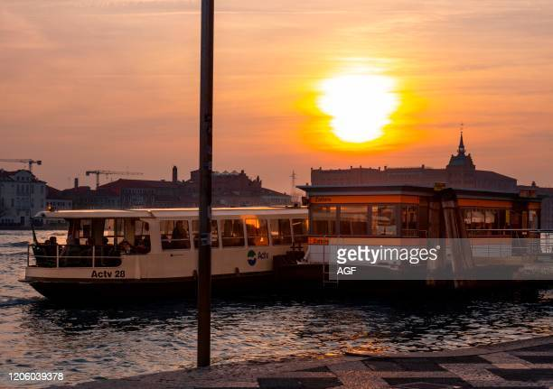 Italy, Veneto, Venice, Canal Grande with Vaporetto stop at sunset.