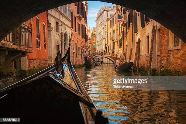 Italy, Veneto, Venice, Gondola under bridge