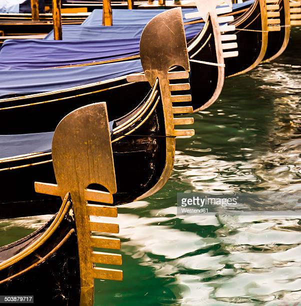 italy, veneto, venice, gondolas, bow decorations - gondola traditional boat stock pictures, royalty-free photos & images