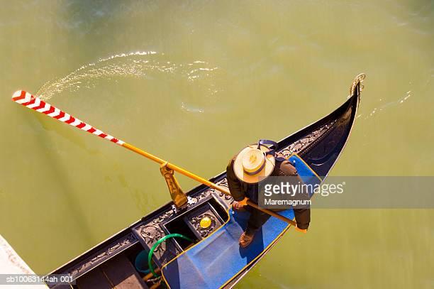 Italy, Veneto, Venice, Grand Canal, Man rowing gondola, elevated view