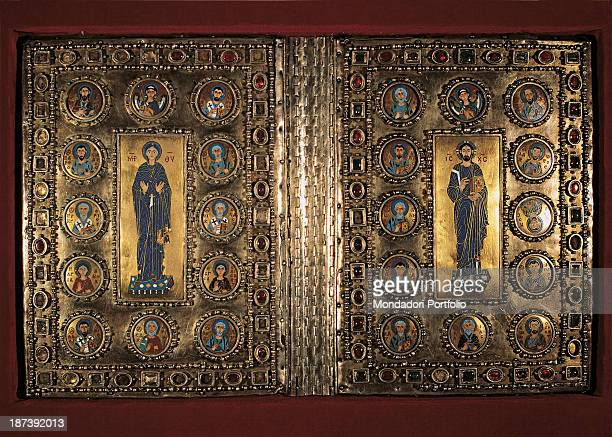 Italy Veneto Venice Marciana Biblioteca All Gilded silver cover on wooden plates decorated with pearls and precious stones Among round medallions...