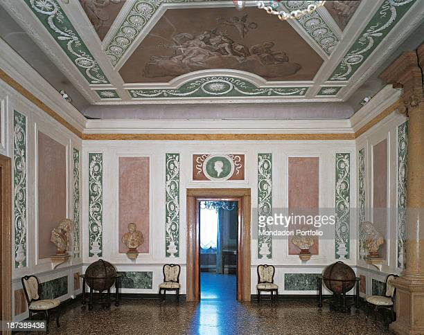 Italy Veneto Venice Palazzo Querini Stampalia View of the interior The room is furnished with chairs seats a globe busts curtains The walls and the...
