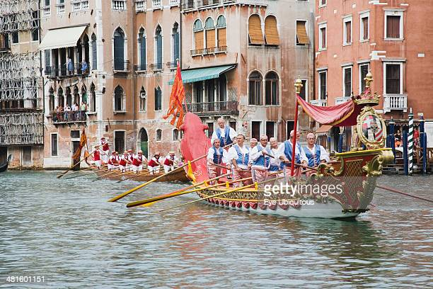 Italy Veneto Venice Participants in the Regatta Storico historical regatta held annually in September in red and gold decorated gondola and wearing...
