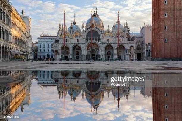 italy, veneto, venice, st mark's square with st. mark's basilica, mirrored - basilica di san marco foto e immagini stock